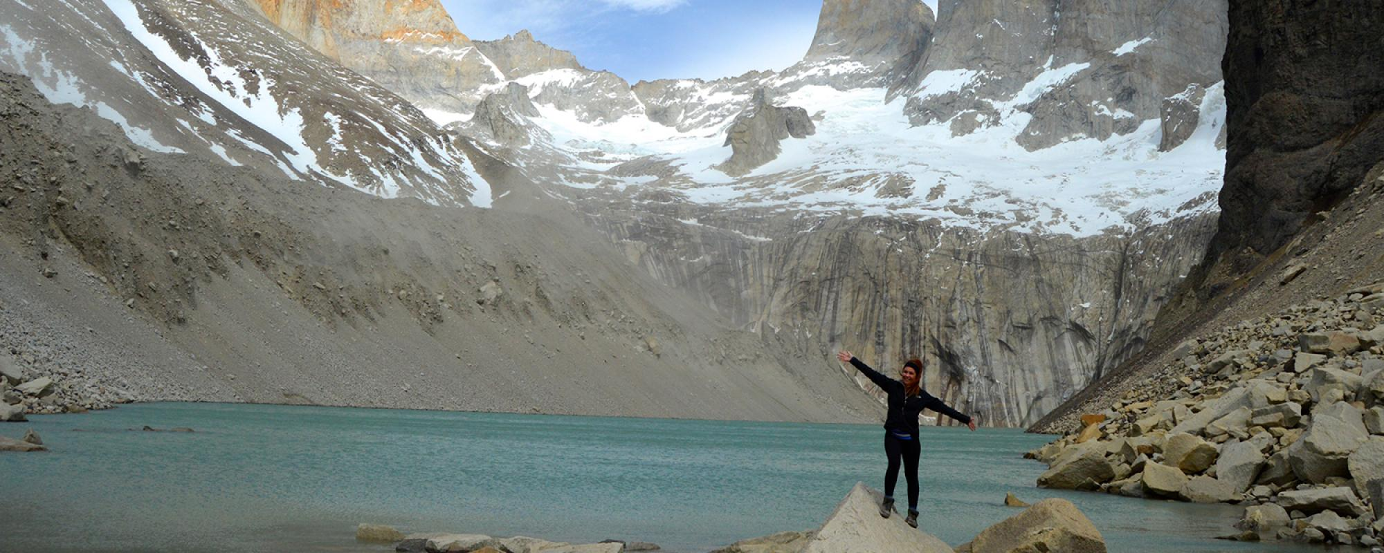 Student at the summit of Torres Del Paine in  Chile
